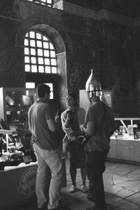 Tourists trying on helmets in the Aya Sofya