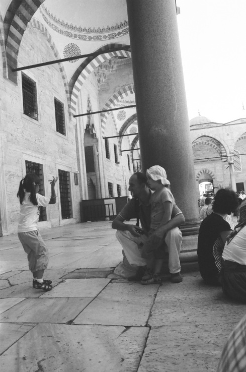 A little girl dancing for her family outside of the Blue Mosque